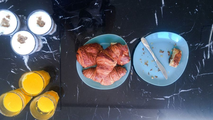 Breakfast in Amsterdam Marbledstone Marble Table Croissant For Breakfast Croissants Knife Empty Plate Orange Juice In Glass Latte Macchiato Glass Coffee From Above  From My Point Of View Sweet Pie Tart - Dessert Apple Pie Puff Pastry Plain Background