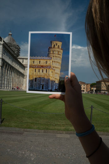 Framed Picturing Individuality Schiefer Turm Von Pisa Architecture Building Building Exterior Built Structure City Close-up Day Finger Grass Hand Holding Human Body Part Human Hand Leisure Activity Lifestyles Nature One Person Personal Perspective Picture Real People Sky Sonya6300
