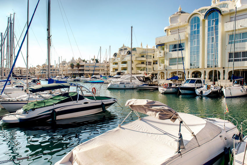 """View of Puerto Marina, that has won the title of """"Best Marina in the World"""" several times. It has a very unusual and modern architecture on 19 december, 2013 Andalucía Architecture Benalmádena Boats Building Exterior Costa Del Sol Europe Famous Place Floating Houses Harbor Landmark Malaga Mediterranean Sea Moored Nautical Vessel Outdoors Port Puerto Marina Benalmadena Sea Ship Sky SPAIN Sunny Day Waterfront Yachts"""
