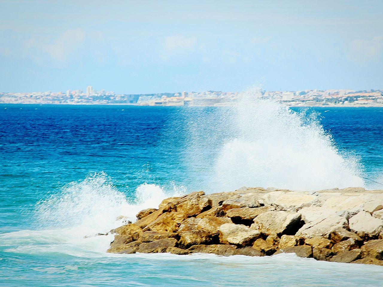 sea, water, beauty in nature, nature, horizon over water, rock - object, motion, blue, sky, no people, day, scenics, power in nature, wave, rough, breaking, crash, force, outdoors