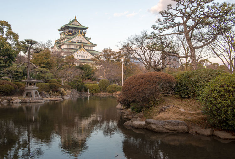 Himeji Castle in Osaka, Japan Tree Water Plant Architecture Built Structure Sky Nature Lake Building Exterior Reflection No People Building Waterfront Religion Day Place Of Worship Belief Tranquility Outdoors