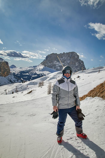 Full length of person on snowcapped mountain against sky