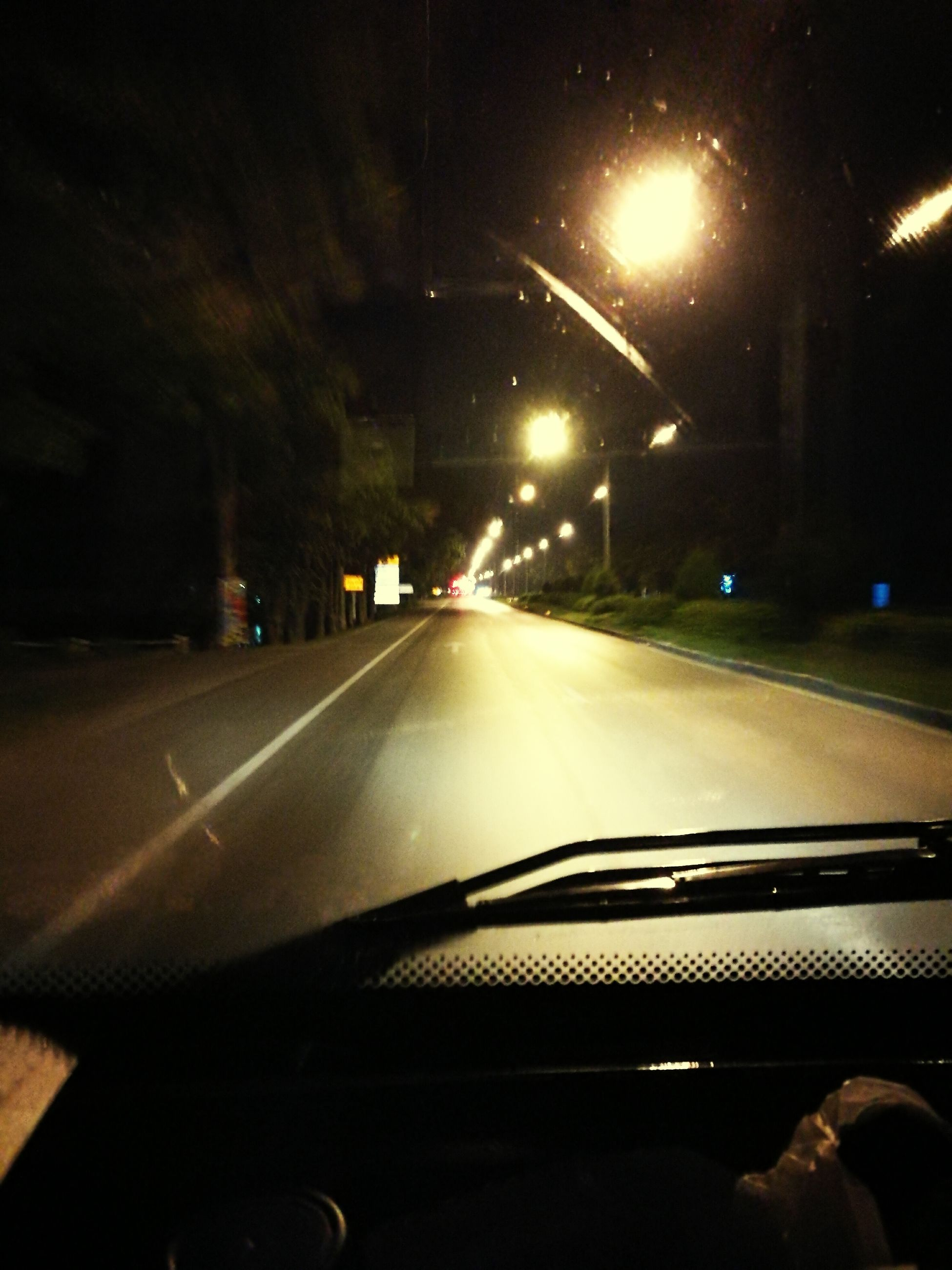 transportation, car, land vehicle, mode of transport, windshield, road, car interior, illuminated, night, vehicle interior, transparent, part of, street, glass - material, car point of view, the way forward, outdoors, windscreen, diminishing perspective, long, journey, no people