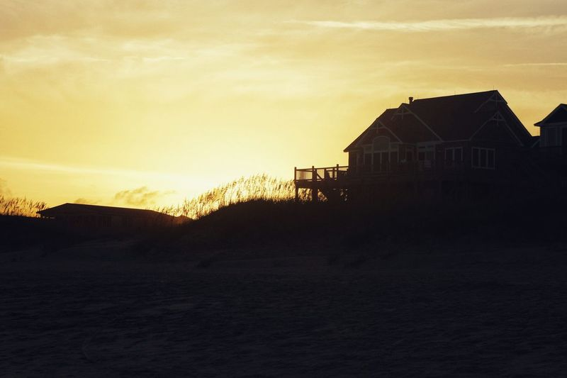Sunset Beach House. Color Of Life Travel Photography Vacations Sunset Ocean Beachphotography Hanging Out Relaxing Enjoying Life Colorsplash Light And Shadow Sky Color Seaside Beach Life Sunset Silhouettes Tranquility