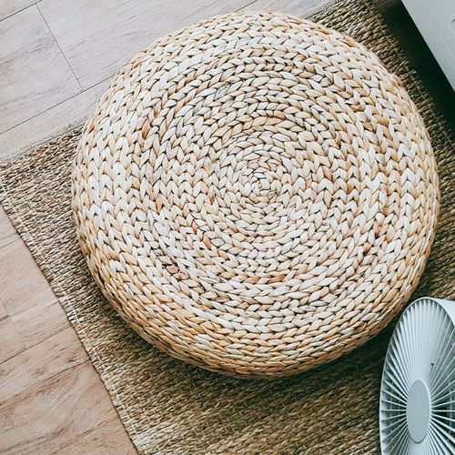 Directly Above View Of Wicker Container On Mat At Home