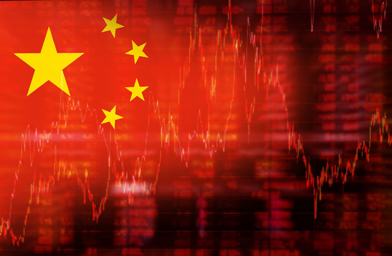 Digital composite image of chinese flag against chart