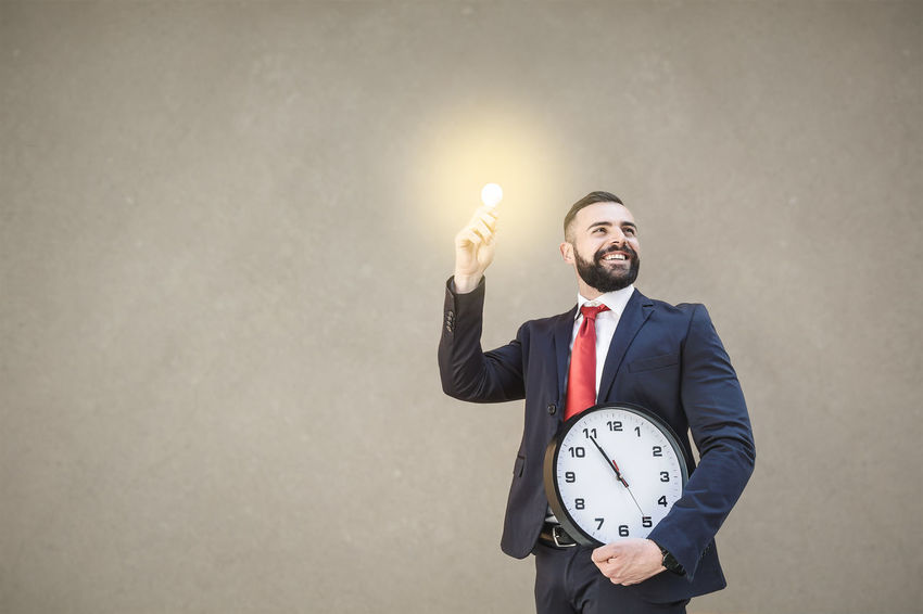 Model: Roberto Materiale Adult Business Business Person Businessman Clock Copy Space Formalwear Front View Full Suit Gesturing Holding Indoors  Males  Men Mid Adult Mouth Open One Person Standing Studio Shot Waist Up Well-dressed