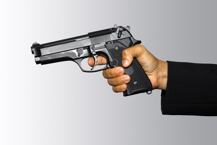 Side view of man using mobile phone against white background