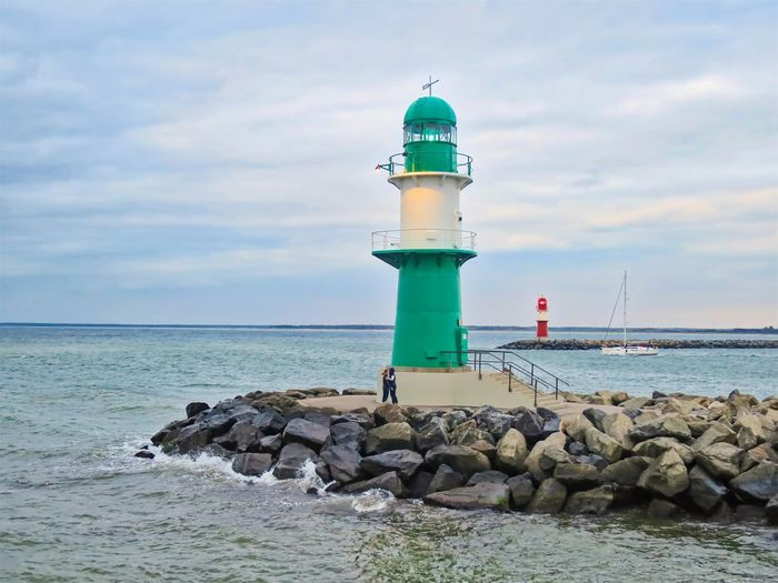 Lighthouse Architecture Built Structure Cloud - Sky Direction Groyne Guidance Horizon Horizon Over Water Kissing Lighthouse No People Protection Rock Rock - Object Safety Scenics - Nature Sea Security Sky Solid Tower Water