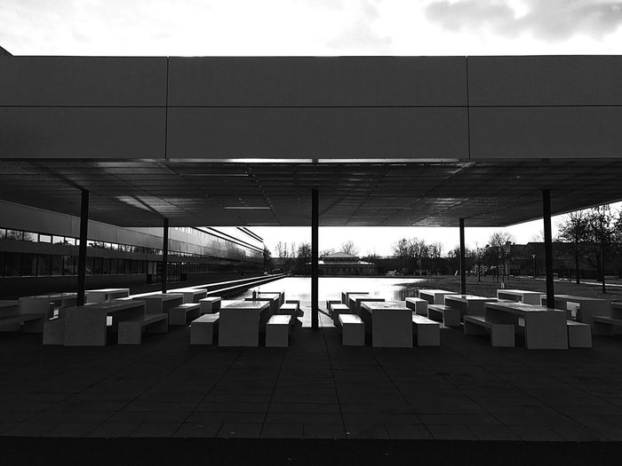 Behind the canteen at University for Applied Science, Neu-Ulm, Germany Lunch Park University Hochschule Neu-Ulm Neu-Ulm Germany Light And Shadow Bnw Bnw_collection Blackandwhite Black & White Wiley Canteen IPhoneography IPhone Iphonephotography Architecture Transportation Day Built Structure No People City Outdoors Nature Building Exterior Seat Glass - Material Modern Sky