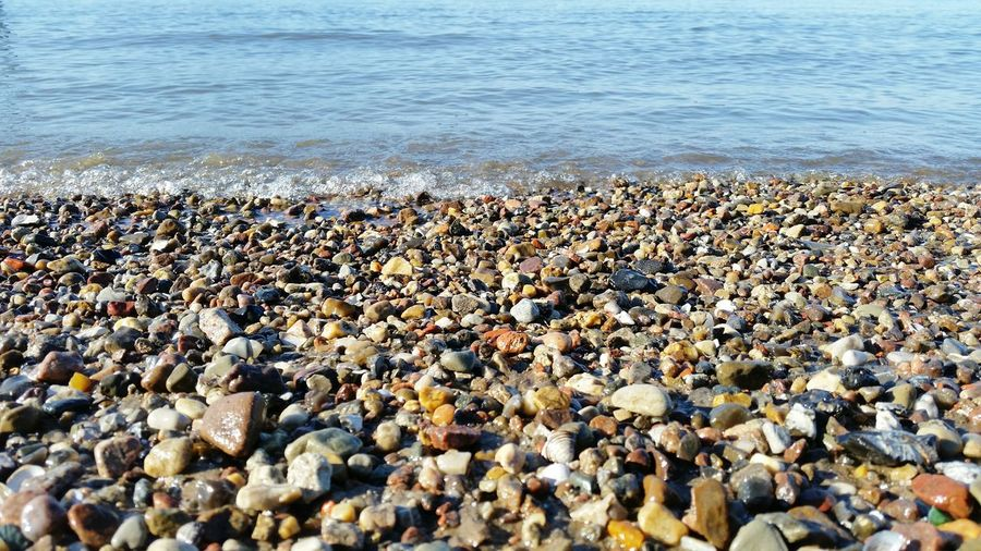 Scenic view of pebbles on beach