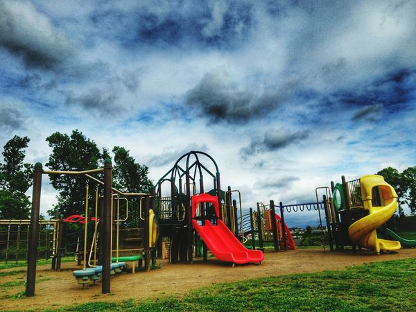 EyeEm Gallery Childhood Outdoor Play Equipment Tree Multi Colored Park - Man Made Space Jungle Gym Playground Sky Cloud - Sky Slide - Play Equipment Merry-go-round Water Slide Slide