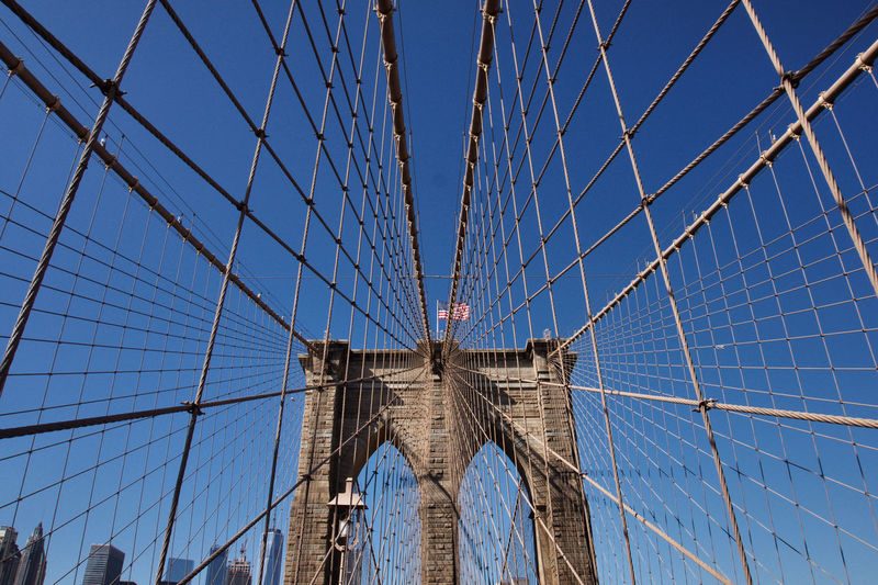Low angle view of brooklyn bridge against clear sky