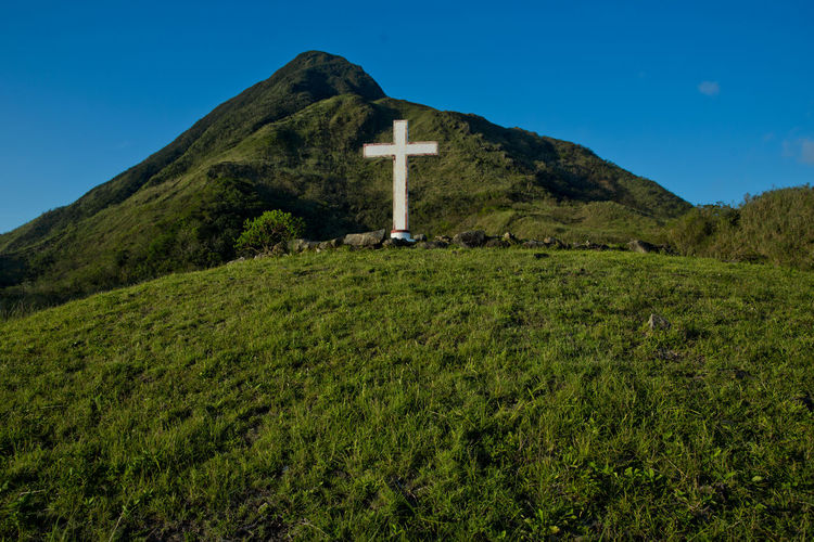 The simple wooden cross on the mountain in Lanyu (Orchid Island ), Taiwan ASIA Ancient Beautiful Cross Grass Islands Orchid Orchids Taitung, Taiwan Taiwan View Hill Historic Island Landscape Lanyu Mountains Outdoors Summer Symbol White Wooden