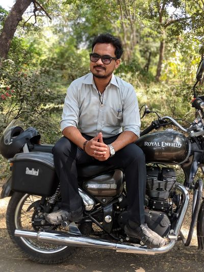 Portrait Portrait Of A Man  Indian Maharastrian EyeEmNewHere Full Length Sitting Tree Biker Men Motorcycle Eyeglasses  Smiling Relaxation Front View