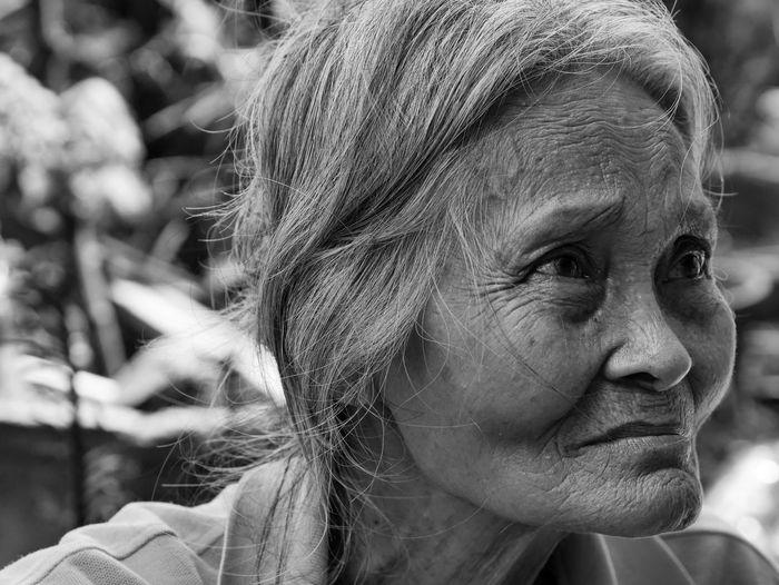 Close-up of senior woman looking away