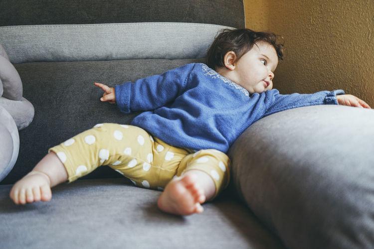 Boy lying on sofa at home