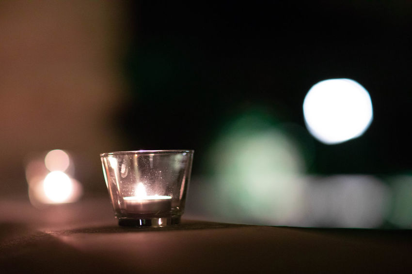 evening illumination Candle Close-up Crockery Cup Drink Drinking Glass Electric Lamp Focus On Foreground Food And Drink Glass Glass - Material Glowing Household Equipment Illuminated Indoors  Light - Natural Phenomenon Lighting Equipment Night No People Refreshment Still Life Table Tea Light