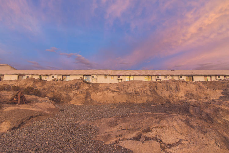 Hotel De Sal Luna Salada - Overlooking The Bolivian Salt Flats at Sunset Beauty In Nature Blue Bridge Bridge - Man Made Structure Built Structure Calm Cloud Cloud - Sky Connection Day Engineering Footbridge Footpath Long Nature Outdoors Scenics Sea Shore Sky Tranquil Scene Tranquility Water
