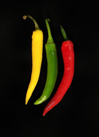 EyeEm Best Shots EyeEm Selects EyeEm Gallery EyeEm Black Background Multi Colored Black Background Studio Shot Red Vegetable Red Bell Pepper Pepper - Vegetable Yellow Food And Drink Red Chili Pepper Green Chili Pepper Chili Pepper Jalapeno Pepper Bell Pepper Chili  Spice Green Bell Pepper Yellow Bell Pepper