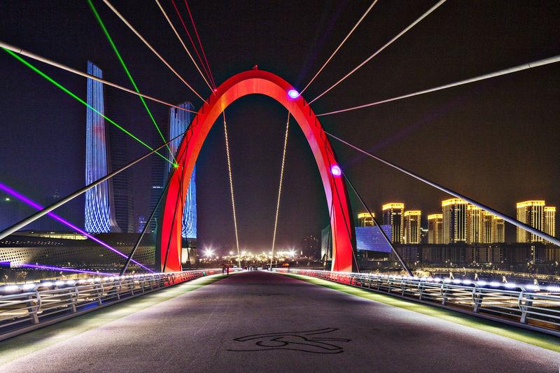 Scenic View Of Illuminated Bridge At Night