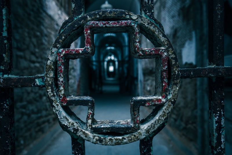 Close-Up Of Plus Sign On Metallic Grate In Corridor At Eastern State Penitentiary