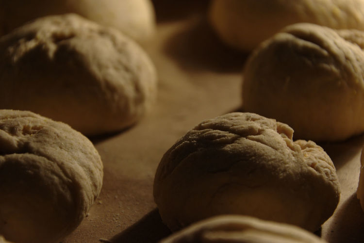 Close-up of bread rolls on baking tray