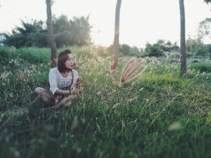 Grass One Person Relaxation Nature Lifestyles Flower People Adult Young Adult Outdoors Day Adults Only