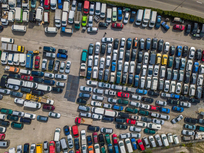 Aerial view of colorful cars parked on parking lot