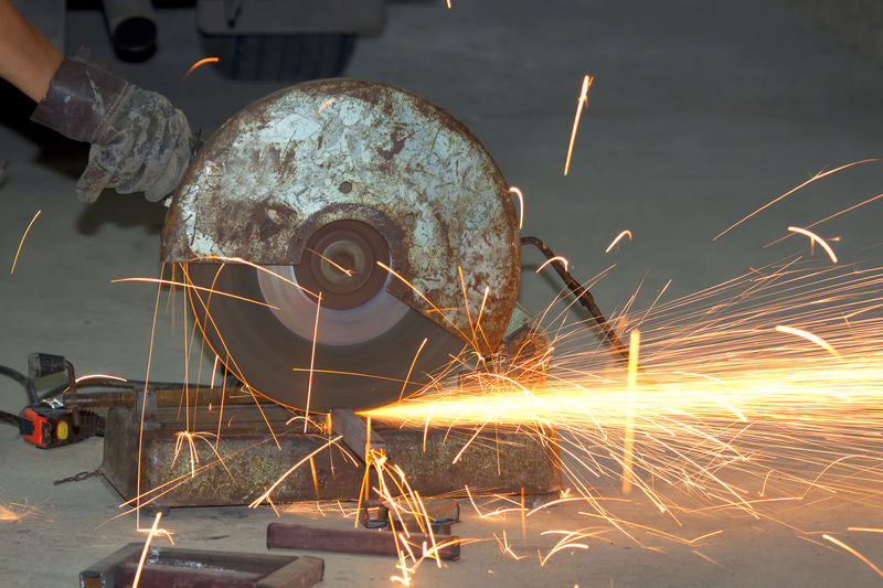 Welding spark industry Blurred Motion Circular Saw Equipment Factory Grinding Heat - Temperature Indoors  Industrial Equipment Industry Iron - Metal Long Exposure Machinery Manufacturing Equipment Metal Metal Industry Motion Occupation One Person Real People Sparks Work Tool Working