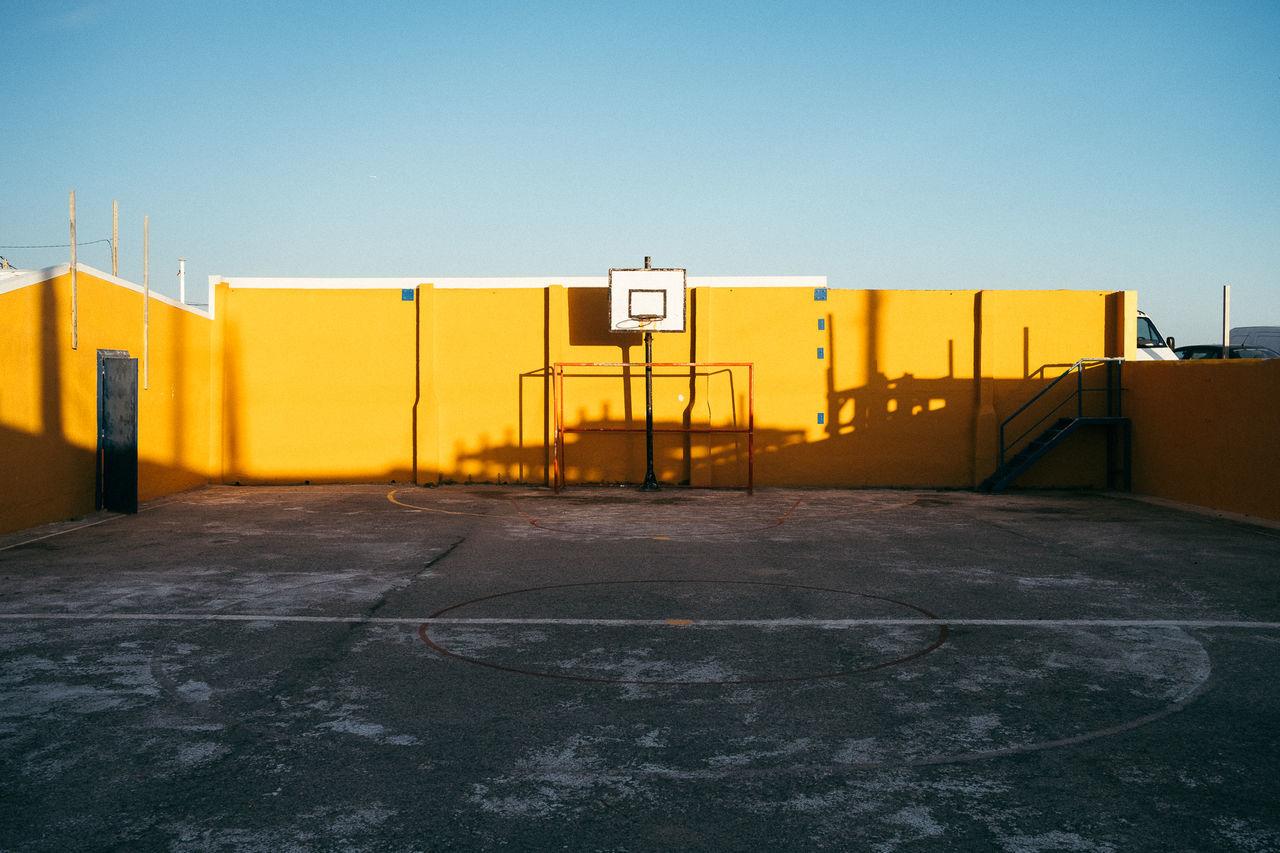 Basketball court against clear sky