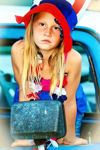 Uniqueness One Person Girl Blond Hair Long Hair Red White And Blue Independence Day 4th Of July Patriotic Old Ford Real People Truck Child Childhood USA America American American Flag