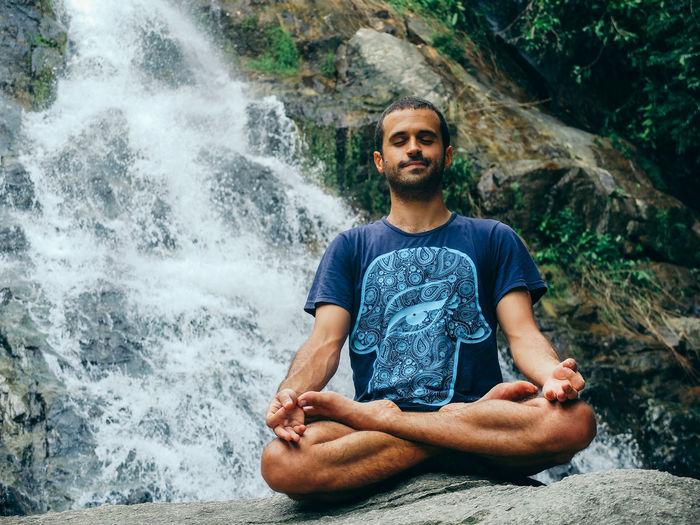 Portrait of man in waterfall