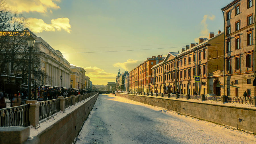 Sky Architecture Building Exterior Built Structure Nature Transportation City Cloud - Sky Incidental People Sunset Mode Of Transportation Outdoors Rail Transportation Street Building Day Sunlight Residential District Connection Canal Real People St. Petersburg St. Petersburg, Russia