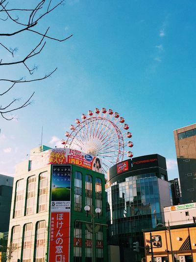 Amusement Park Ride Architecture Building Exterior Built Structure City City Cityscape Day Ferris Wheel Japan Low Angle View No Clouds No People Outdoors Sapporo Sky Skyline