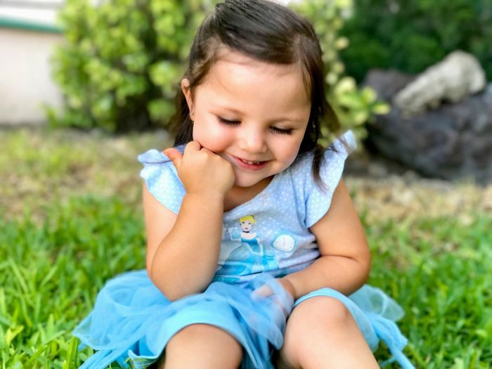 Close-up of girl sitting on grass