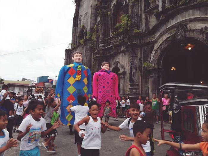 Kids teasing the higantes in Lucban City Crowd Friendship Young Women Togetherness Child Women Boys Multi Colored Men Festival Place Of Worship