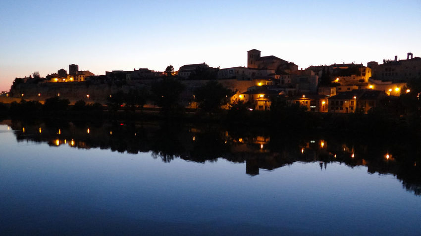 ezefer Reflection Building Exterior Architecture Water Built Structure Sky Illuminated Building City Nature No People Waterfront Clear Sky River Dusk Residential District Night Outdoors Cityscape Zamora Zamora, Spain