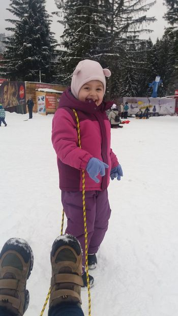 snow fun Winter Cold Temperature Snow Smiling Childhood Child Girls Warm Clothing Outdoors Day One Person Fun One Girl Only Looking At Camera Real People Cheerful Children Only Mobility In Mega Cities