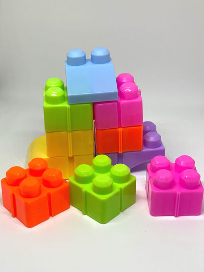 Close-up of toys against colored background