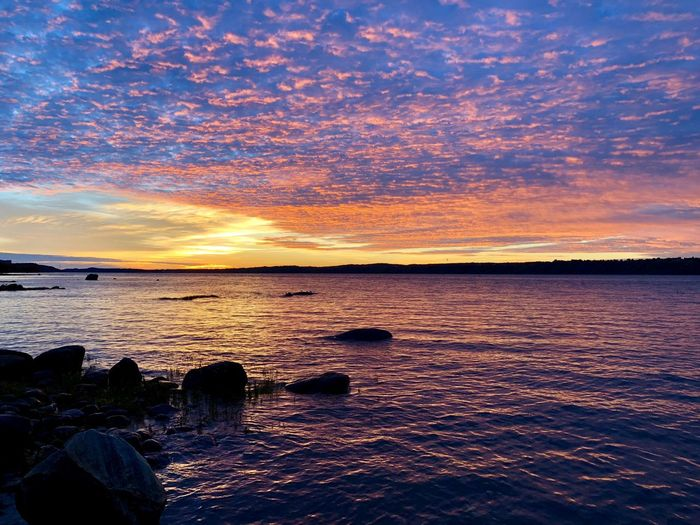 Saint Lawrence River/Fleuve Saint-Laurent Water Sea Sky Scenics - Nature Beauty In Nature Sunset Cloud - Sky Tranquility Beach Tranquil Scene Land Idyllic Nature No People Rock Orange Color Solid Low Tide Reflection Horizon Over Water