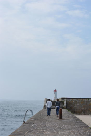 A walk on the Pier, down on the Walk Way -some Friendships are special. Horizon Over Water Lighthouse Ocean Ocean View Peace And Quiet Quay Scenics Sea Sky The Way Forward Tranquil Scene Tranquility Walkway Water People Walking  People Walking Away People Walking At A Distance People Walking On Pier Europe