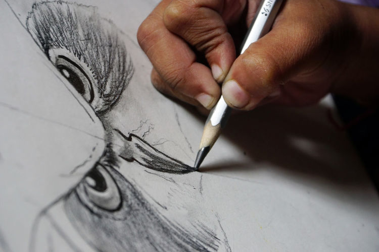 Creativity Human Hand Art And Craft Hand Human Body Part One Person Pen Close-up Drawing - Activity Paper Indoors  Holding Sketch Real People Occupation Drawing - Art Product Body Part Artist Skill  Pencil Drawing Finger Design Professional Drawing Art Pencil Artist Pencil Art