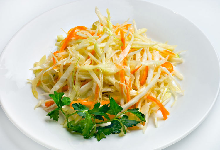 Close-up of fresh cabbage with coriander served in plate