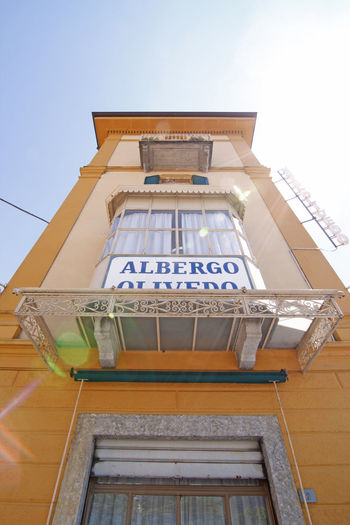 Historical albergo Olivedo - Varenna Como Lake Italy Albergo Olivedo Architecture Back Light Balcony Building Exterior Clear Blue Sky Colorful Historical Building Hotel Lago Di Como Lake Como Low Angle View Narrow No People Old Point Of Interest Summer Sunbeam Sunlight Varenna Worms Eye View Yellow Facade