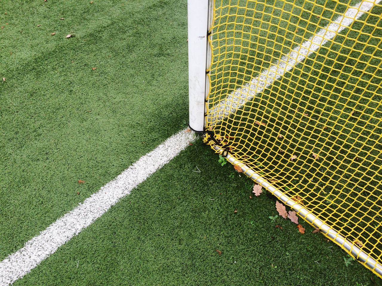 Close-up of net on soccer field