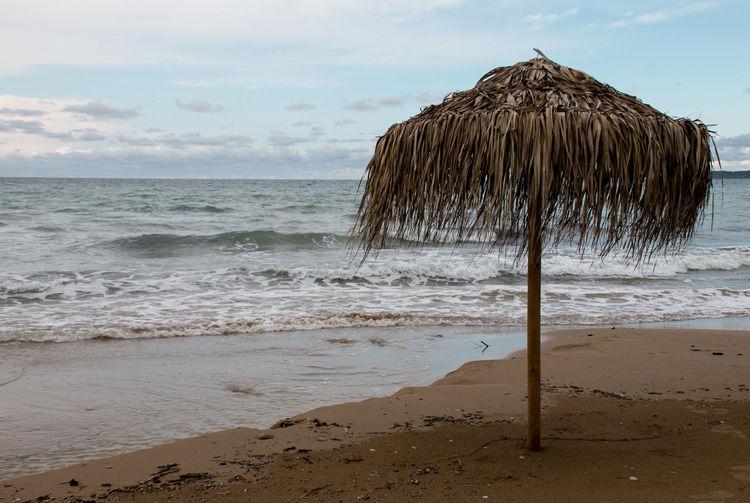 Parasol on beach against sky