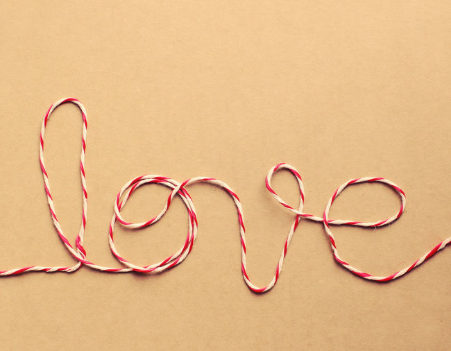 High angle view of love text made from string