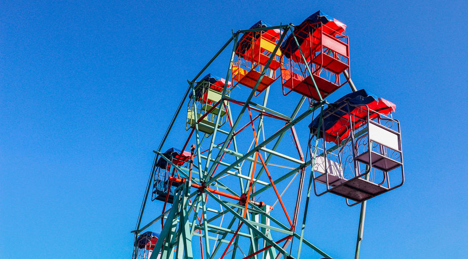 Ferris wheel Sky Clear Sky Blue Low Angle View Nature Day Outdoors Fun Enjoyment Ferris Wheel Red Festival Holiday Summer Color