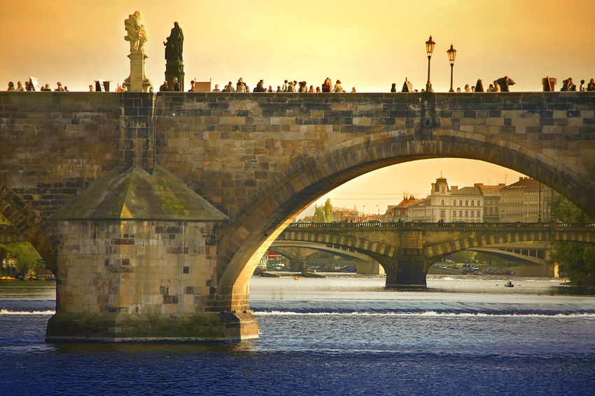 A picturesque view of Charles Bridge in Prague Beer Bohemia Castle Cityscape Czech Gate Gothic Holiday Prague Romance Romantic Trip Attraction Baroque Bridge Cultural Czechoslovakia Dramatic Dusk Emotion Europe History Landmark Picturesque Vacation